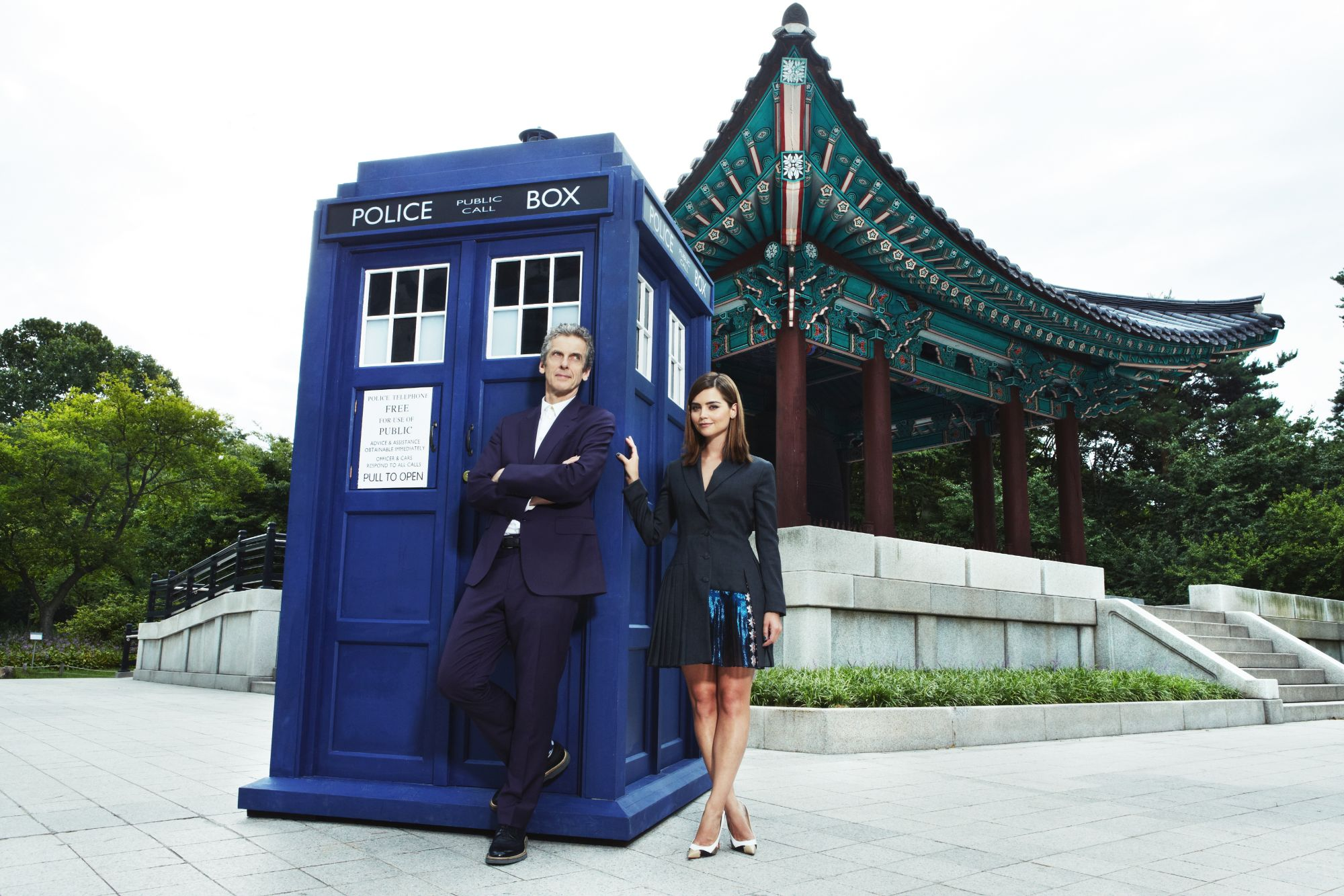 Peter Capaldi, Jenna Coleman and the TARDIS at the historic Bosingak bell at the National Museum of Korea.  (Doctor Who World Tour - Seoul) (Credit: BBC Worldwide)