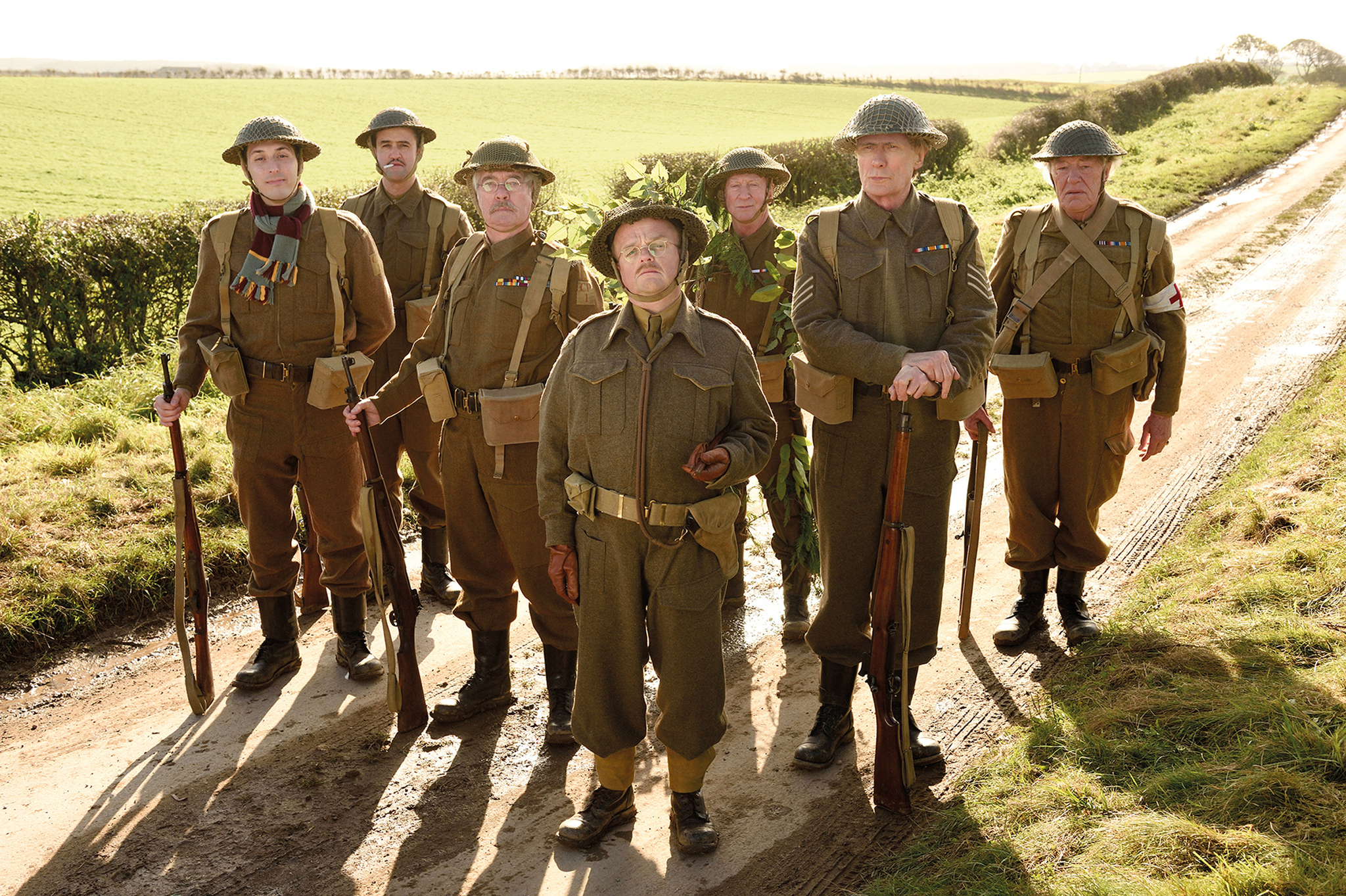 The main cast of the 2015 Dad's Army film - (left to right) Frank Pike (Blake Harrison), Walker (Daniel Mays), Jones (Tom Courtenay), George Mainwaring (Toby Jones), Arthur Wilson (Bill Nighy), Frazer (Bill Paterson), Godfrey (Michael Gambon) (Credit: Universal Pictures/PA Wire)