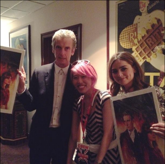 Alice X. Zhang presents her artwork to Peter Calpaldi and Jenna Coleman (Credit: Titan)