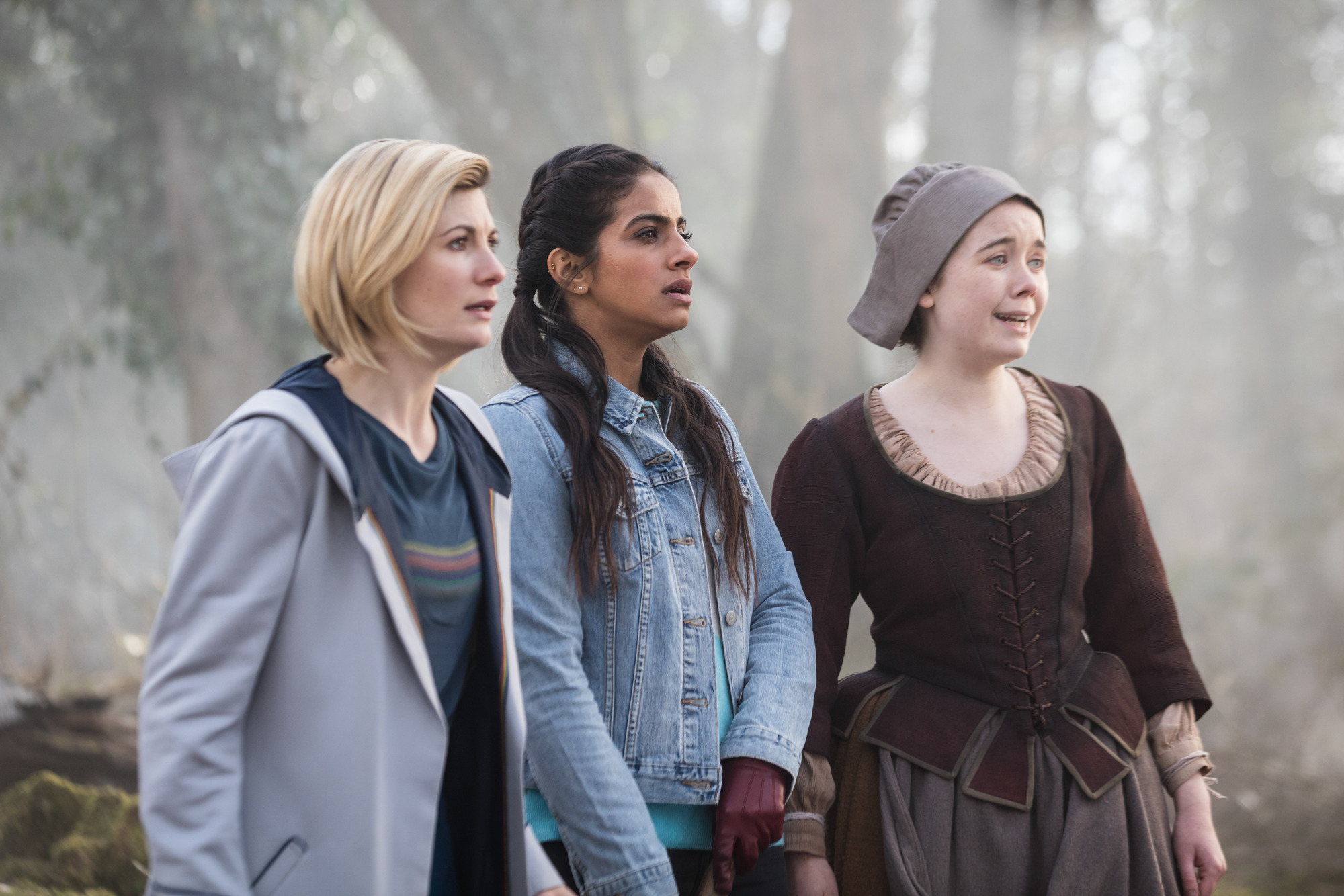 The Witchfinders: The Doctor (Jodie Whittaker), Yaz (Mandip Gill), Willa Twiston (Tilly Steele) (Credit: BBC Studios (Sophie Mutevelian ))