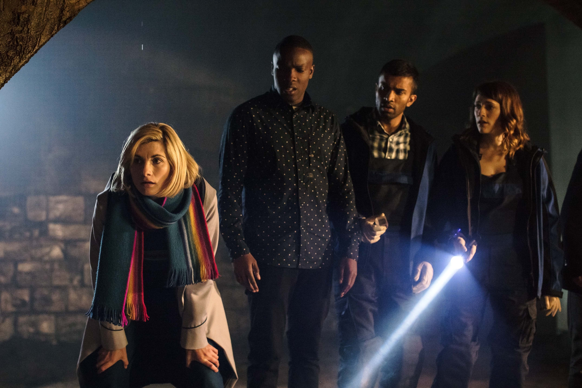 Resolution: The Doctor (JODIE WHITTAKER), Ryan (TOSIN COLE), Mitch (NIKESH PATEL), Lin (CHARLOTTE RITCHIE) (Credit: BBC/Sophie Mutevelian)